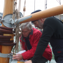 Andy Cassell and Darryl fitting the mainsail